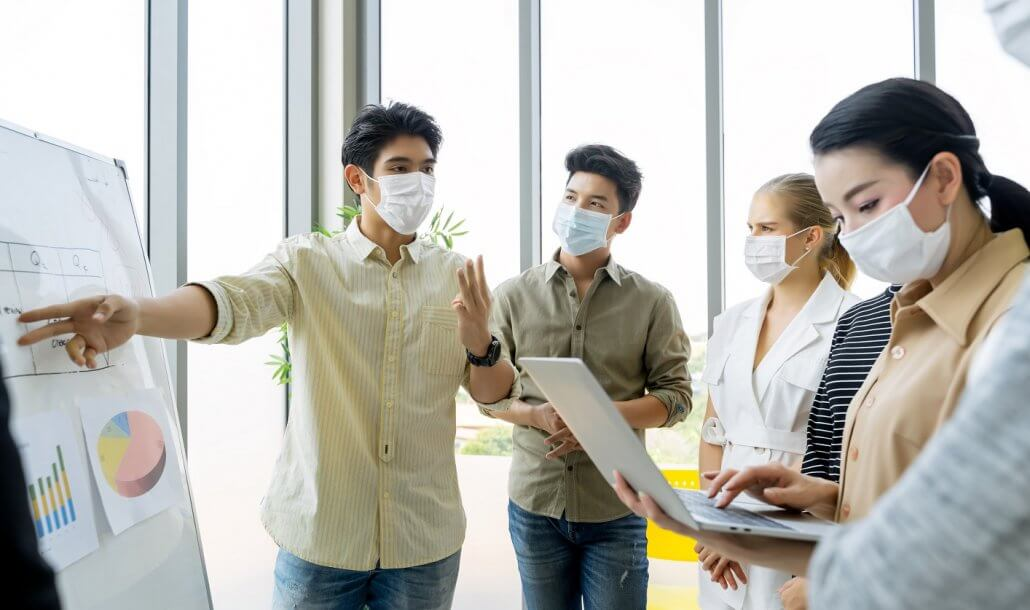 cpa firms near me help employee retainment during covid as employees wear masks and see demonstration